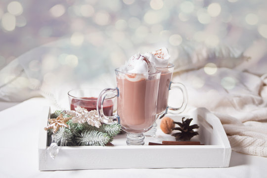 Two glass of cocoa on the white tray on the bed early winter morning