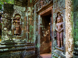 Carved in stone sculptures at Vat Phou or Wat Phu that is ruined Khmer Hindu temple in Champasak, Southern Laos.