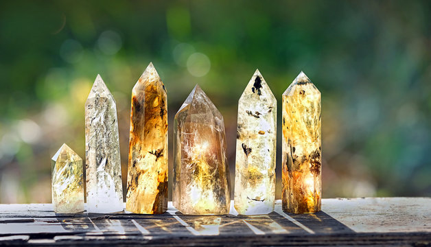 quartz stones mineral. beautiful gemstones crystal on abstract blurred nature background. gems for relaxation, quartz crystals. Crystal Ritual, Witchcraft Crystal. copy space