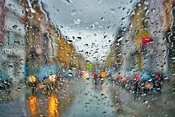 Obraz Car driving in rain and storm abstract background - fototapety do salonu
