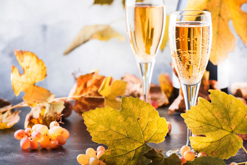 Champagne wine in glass background. Autumn still life, wine tasting table setting concept