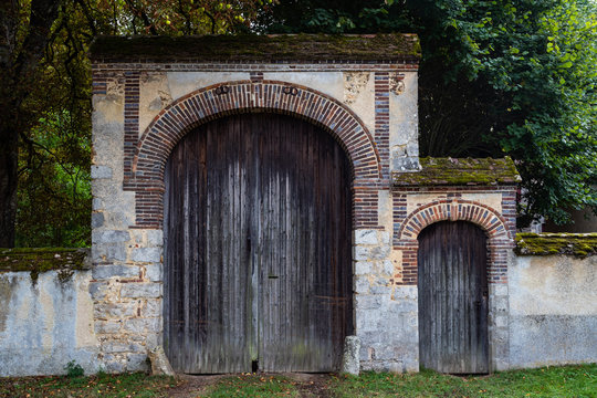 Large and small castle doors entrance  in rural France