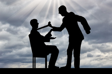 Silhouette of a standing nurse holds a man who is sitting on a chair against a cloudy sky by a tie