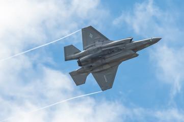 Low level aerobatics by a Lockheed Martin F-35B Lightning II in the skies over Farnborough, UK - July 5, 2016