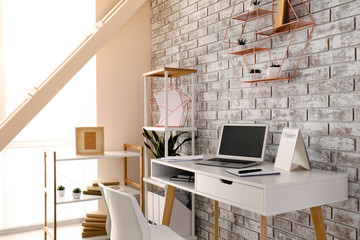 Interior of modern room with comfortable workplace
