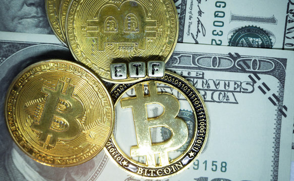 Bitcoin coin with ETF text Put on  money dollar , Concept Entering the Digital Money Fund.