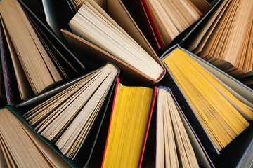 Stack of hardcover books as background, top view Fotobehang