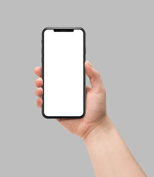 Woman hand holding smart phone with blank screen isolated on gray. Template, mockup, model, modern, design.