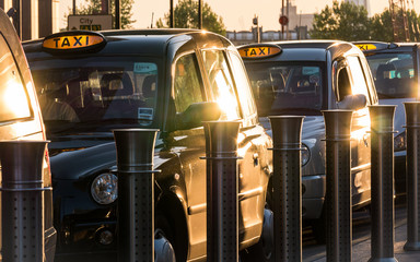 London black taxi cabs at a rank waiting for passengers in the Docklands business district.