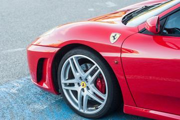 Mulhouse - France - 13 October 2019 - Closeup of red Ferrari F430 parked in the street