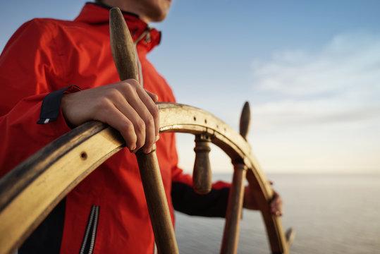 Captain Holding Hands on ship rudder