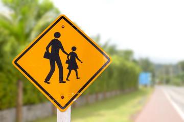 School zone sign board near the road