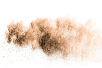 Freeze motion of brown powder exploding. Abstract design of brown dust cloud against white...