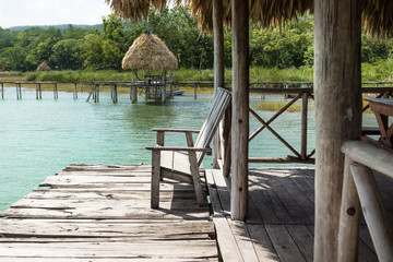 Lake dock with chair, El Remate, Guatemala