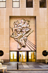NEW YORK CITY, USA - FEBRUARY 4, 2010: Entrance with sculptiure by Isamu Noguchi on Rockefeller Plaza, in New York, USA . The relief was installed on April 29, 1940