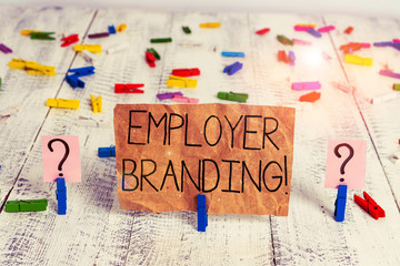 Text sign showing Employer Branding. Business photo text promoting company employer choice to desired target group Scribbled and crumbling sheet with paper clips placed on the wooden table