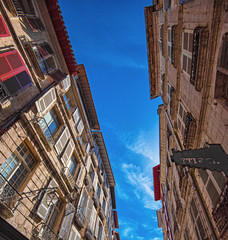Houses with narrow street in Bayonne, France