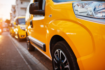Yellow taxi in the parking lot waiting for the client. Taxi on the street.