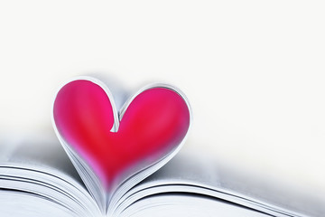 Heart shaped book sheets. Open book, red heart, toned image