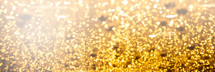 Christmas and new year banner with gold bokeh lights abstract background