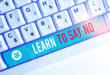Writing note showing Learn To Say No. Business concept for decline or refuse few things before you destroy yourself White pc keyboard with note paper above the white background