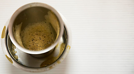 Empty glass cup of coffee, South Indian filter coffee is famous coffee in steel cup with space for text
