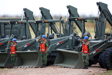 Military personnel attend an official event to mark the beginning of the construction of a new international airport, at the Santa Lucia military airbase in Zumpango