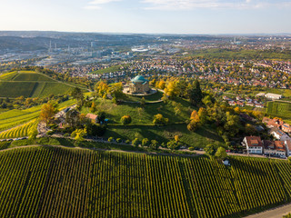 Aerial of the Grave Chapel (Grabkapelle) on Rotenberg and surrounding industrial area with museums and soccer stadium on a beautiful autumn day in Stuttgart, Germany