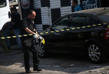 A federal police expert is seen near a site where an armed gang holds people hostage after they robbed a securities company at the Viracopos airpoart freight terminal, in Campinas