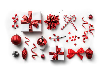 Fototapete - Christmas gift boxes with red ribbon, sparkles, confetti and decoration on white background. Xmas and Happy New Year holiday. Flat lay, top view