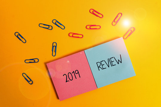 Writing note showing 2019 Review. Business concept for New trends and prospects in tourism or services for 2019 Colored square blank sticky notepads sheets clips color background