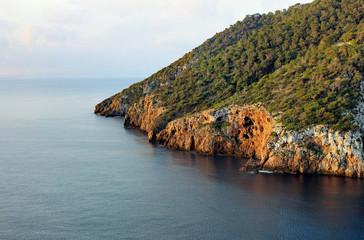 Idyllic coastal area of balearic island Ibiza with wooden cliffs