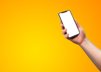 Woman hand holding smart phone with blank screen isolated on yellow Template, mockup, model, modern, design.