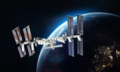 ISS space station on orbit of the Earth planet. Blue light on background. Elements of this image furnished by NASA