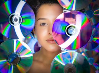 Portrait of beautiful woman among CDs