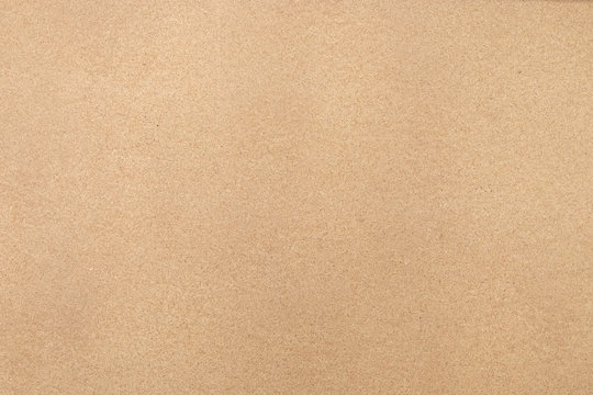 Light brown background Background image of compressed paper Or crate paper Looks like a small noise