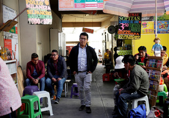 Bolivian Reynaldo Kantuta, a computer engineer who does not agree with the re-election of President Evo Morales, walks at the Lanza market in La Paz