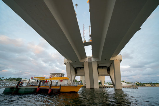 People on the Fort Lauderdale water taxi under the 17th Street Bridge