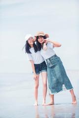 two cheerful asian teenager happiness on sea beach