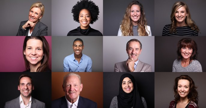 Group of beautiful people in front of a colored background
