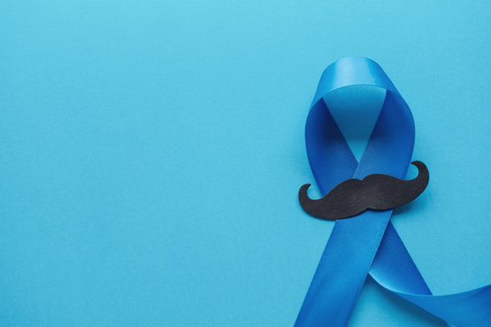 Light blue ribbons with mustache on blue background , Prostate Cancer Awareness, Movember Men health awareness,International Men's Day