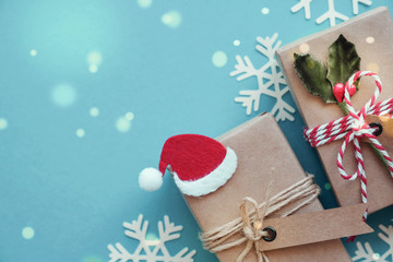 Eco gift boxes with Christmas snowflake decoration on green pastel background, Festive holidays background