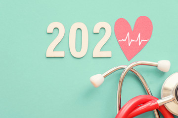 2020 wooden number with red stethoscope. Happy New Year for heart health and medical concept, life insurance business