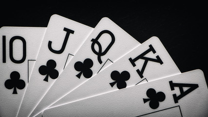 Royal Flush on a black background, a very rare poker hand