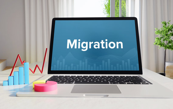 Migration – Statistics/Business. Laptop in the office with term on the display. Finance/Economics.