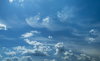 Some light cumuliform and cirrus clouds in the clean blue sky.
