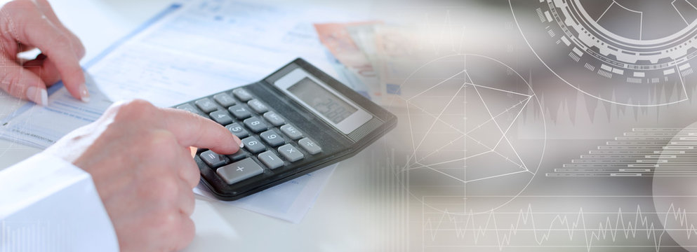 Woman accountant with calculator; panoramic banner