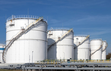 Oil storage tanks and pipes at the oil terminal