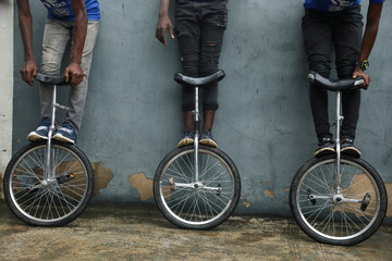 Members of the GKB academy, a unicycle club, pose for a photo with their unicycles during a training session in Lagos