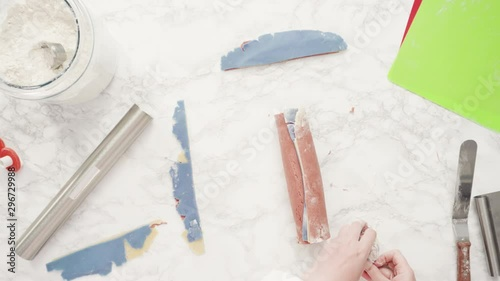 Wall mural Step by step. Flat lay. Rolling out dough with a rolling pin to bake red, white, and blue pinwheel sugar cookies.
